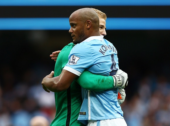 Manchester City goalkeeper Joe Hart hugs Vincent Kompany at the end of the Barclays Premier League match between Manchester United and Chelsea played at the Etihad Stadium, Manchester