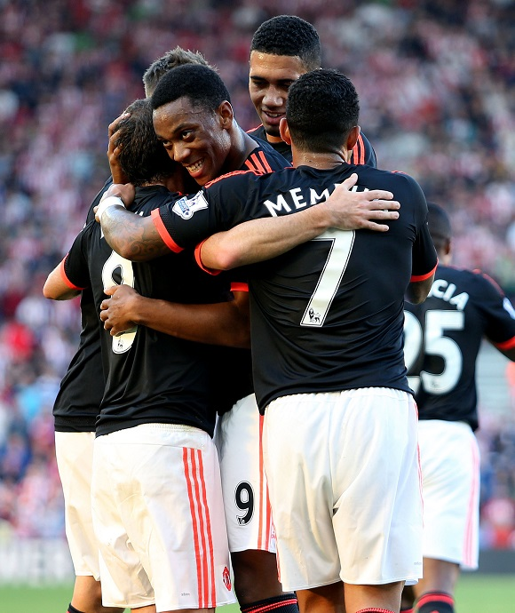 Juan Mata celebrates scoring his sides third goal with Anthony Martial during the Barclays Premier League match between Southampton and Manchester United played at St Mary's, Southampton