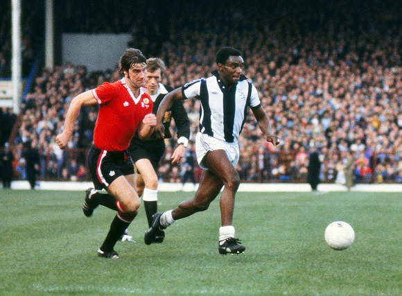 Football - 1977 / 1978 First Division - West Bromwich Albion 4 Manchester United 0 West Brom's Laurie Cunningham, right, and United's Martin Buchan at the Hawthorns. 22/10/1977 - photographed: October 22, 1977