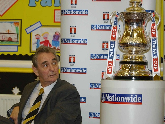 Former Manager Brian Clough (died September 2004) With His Son Nigel Clough Who Is The Manager Of Burton Albion Fc. The Pair Took The Fa Cup To Holy Trinity School In Burton-upon-trent To Meet The Children And To Promote Nigel's Team Burton Albion And Their Fa Cup 2nd Round Match Against Hartlepool. 4th December 2003...